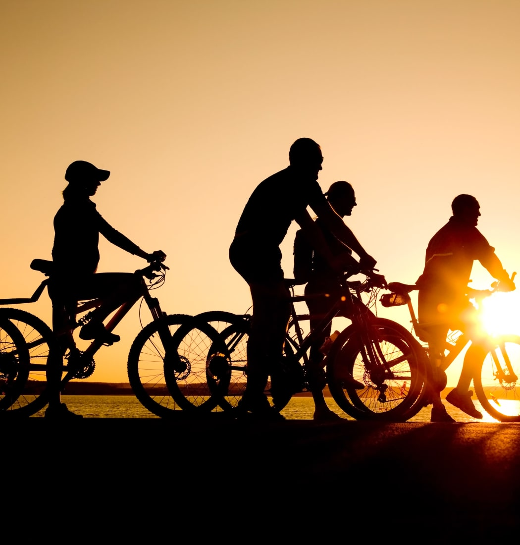 Bicyclists at sunset near The Fairways in Worcester, Massachusetts