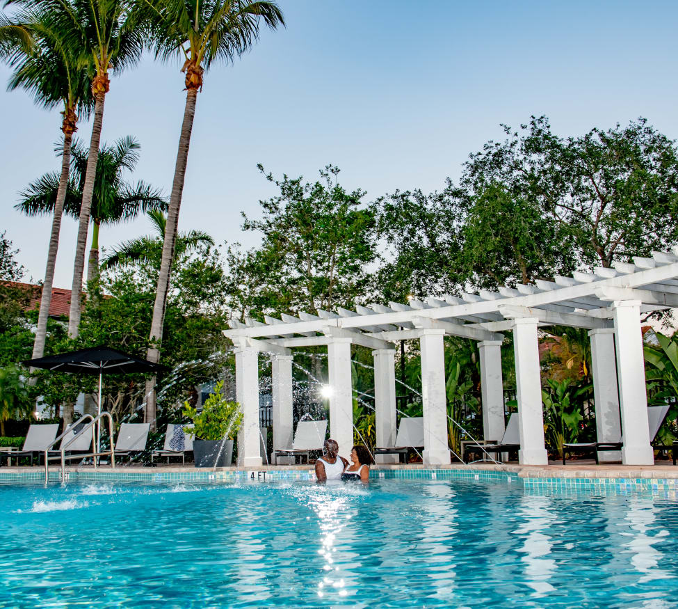 Residents enjoying one of the luxury swimming pools at The Sophia at Abacoa in Jupiter, Florida