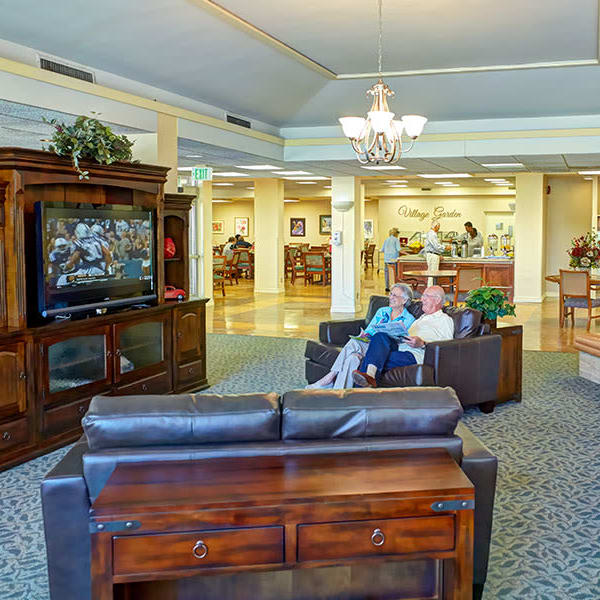 Residents relaxing and watching TV at Monte Vista Village in Lemon Grove, California