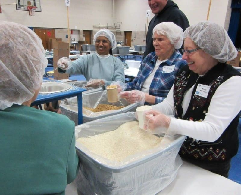 Residents from Deephaven Woods helping at a homeless shelter in Deephaven, Minnesota