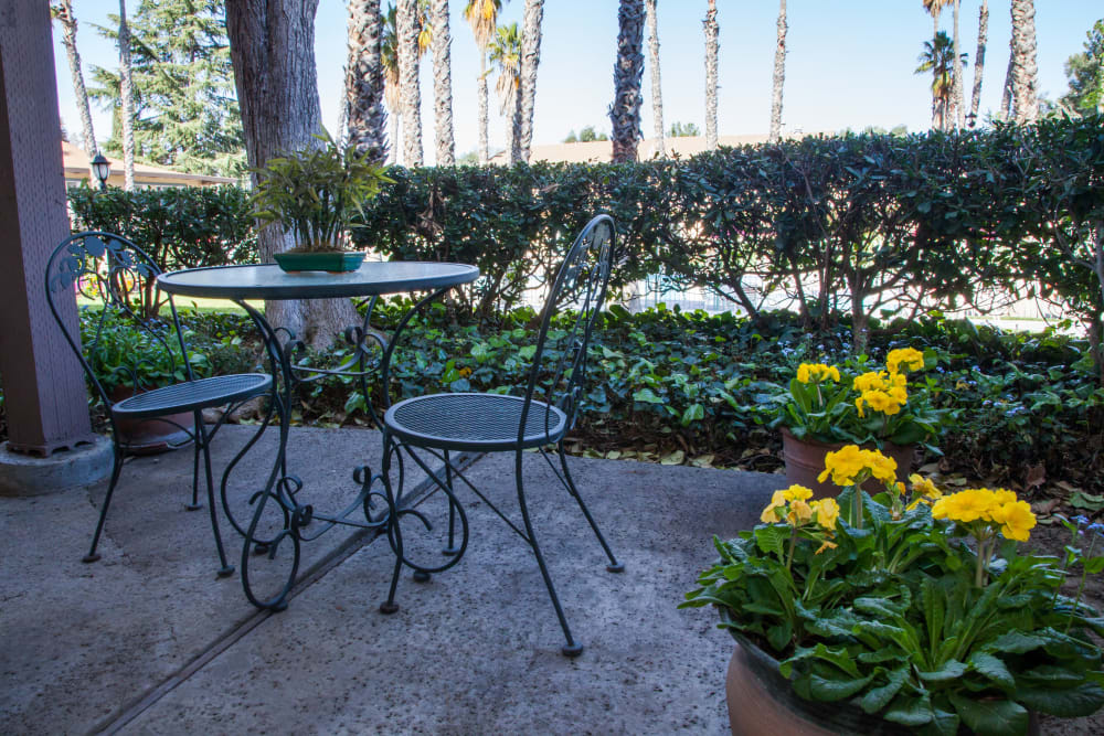 Outdoor seating area for two at Valley West Apartments in San Jose, California