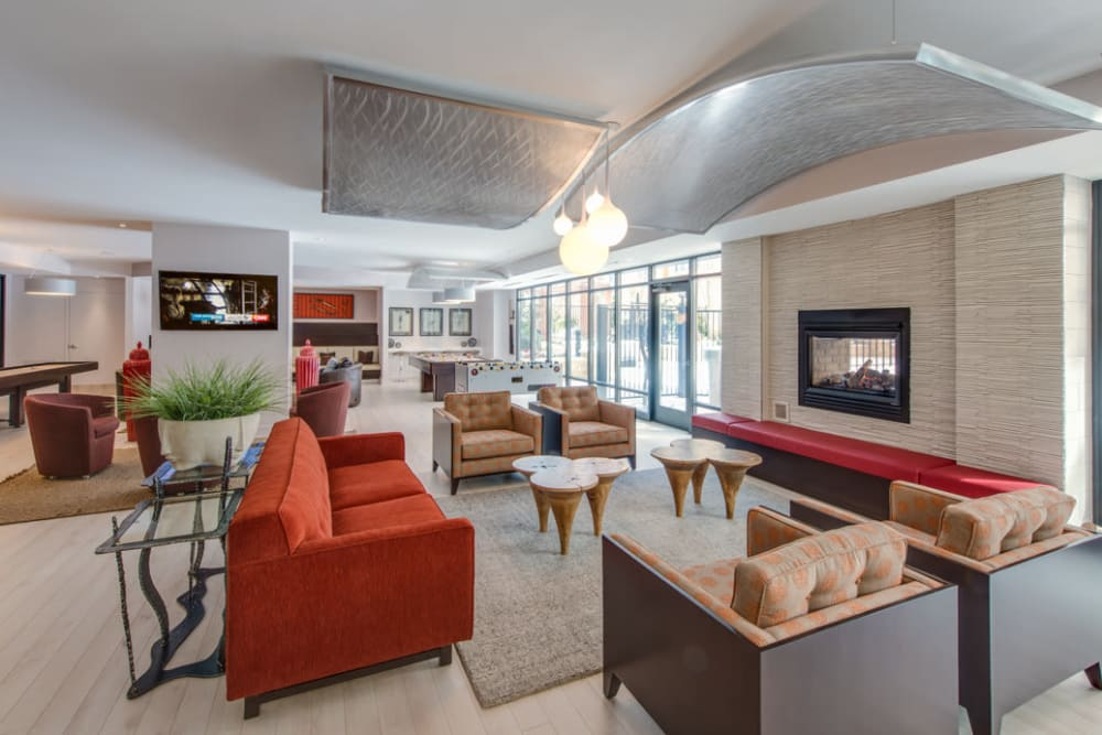 Lobby with large fireplace and seating at Solaire 10914 Georgia in Silver Spring, Maryland