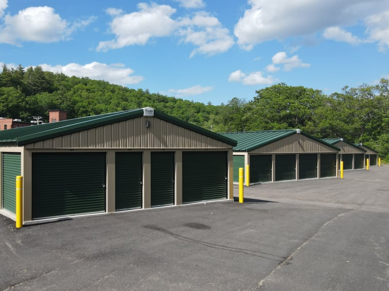 A row of outdoor units with green doors at 603 Storage - West Milford in Milford, New Hampshire