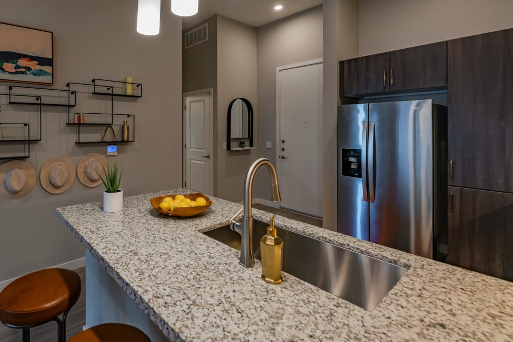 A kitchen with stainless-steel appliances at Encore Tessera in Phoenix, Arizona