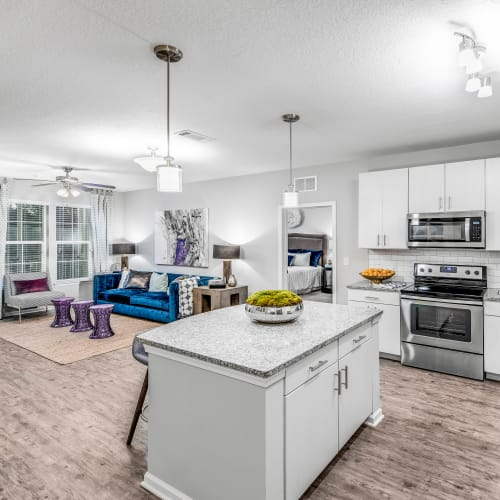 View of the living area from the kitchen of an open-concept model home at Canopy at Citrus Park in Tampa, Florida