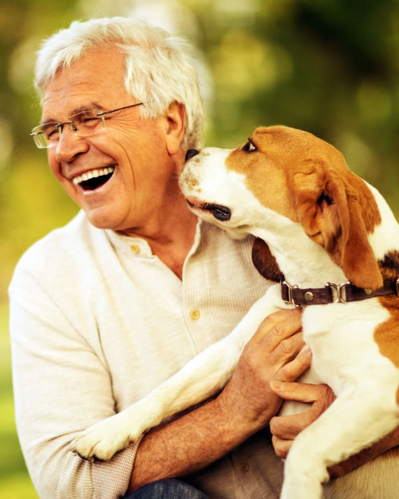A Man and his dog at Spring Creek Village in Spring, Texas