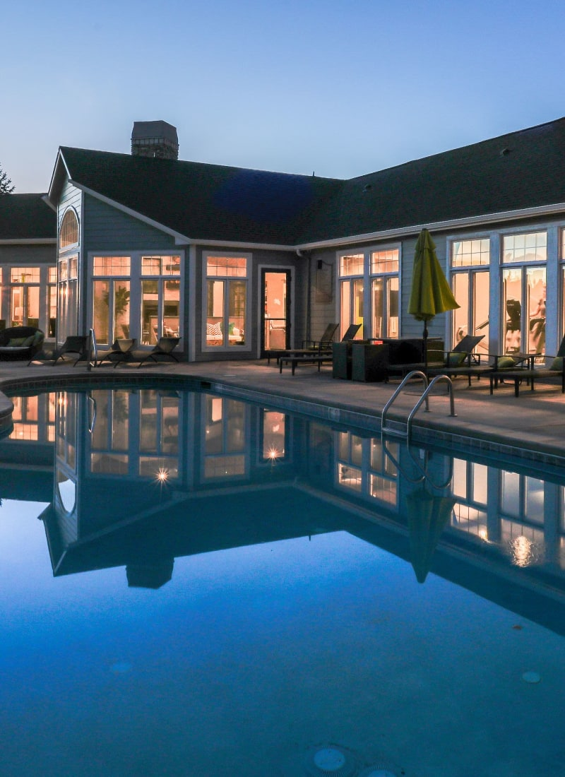 Swimming pool at sunset overlooking units at Marquis Castle Pines in Castle Pines, Colorado