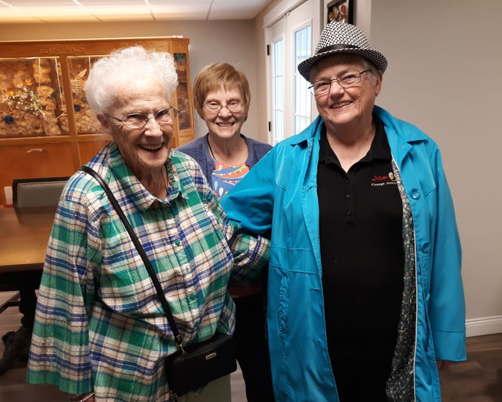 Smiling faces from residents at Corridor Crossing Place in Cedar Rapids, Iowa.