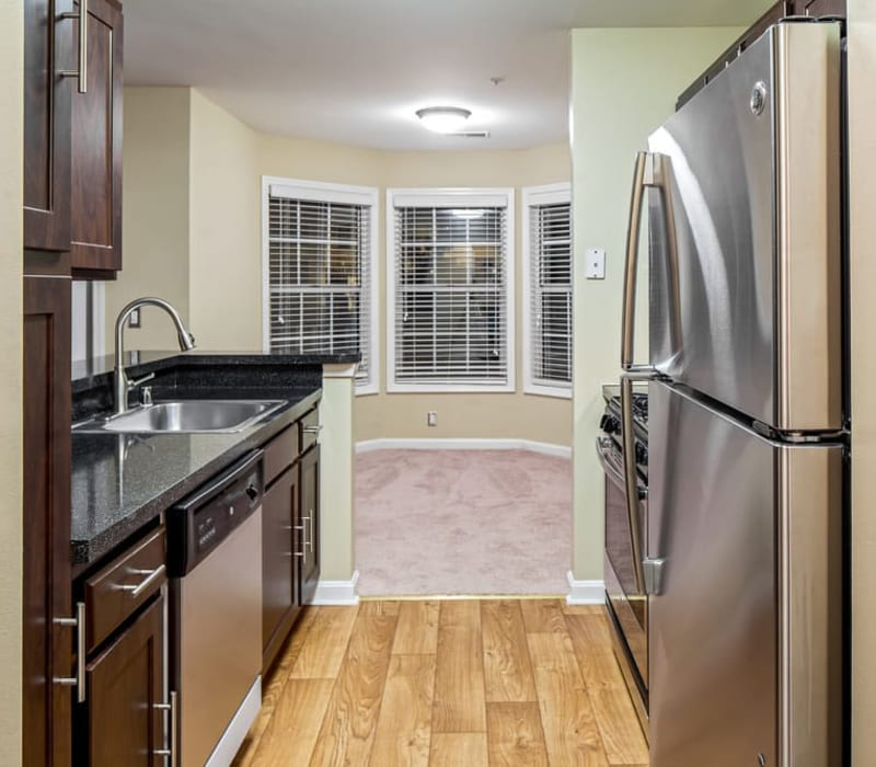 Kitchen with stainless steel appliances at Sussex at Kingstowne in Alexandria, Virginia