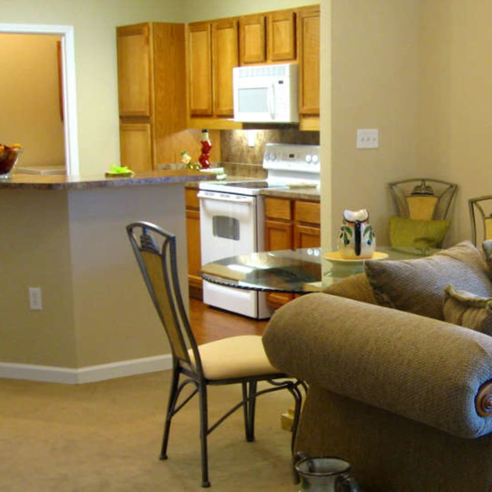 Living room and kitchen at Grand Villa of Palm Coast in Palm Coast, Florida
