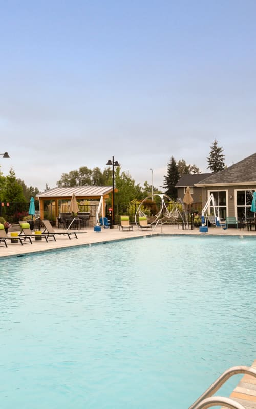 Sparkling Pool View with Lounge Chairs at Terrene at the Grove in Wilsonville