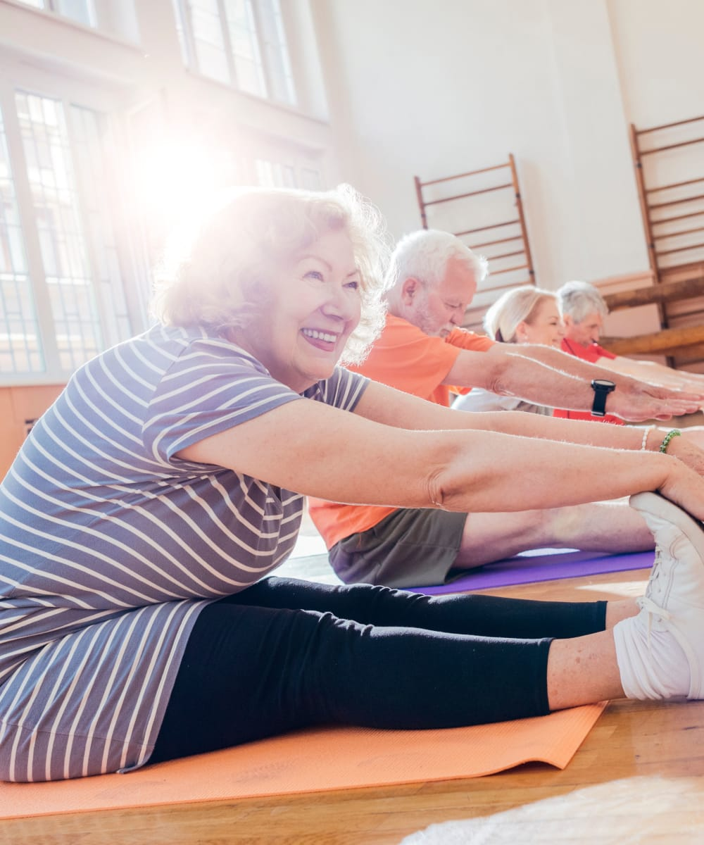 Seniors stretching at Hillcrest of Loveland in Loveland, Colorado
