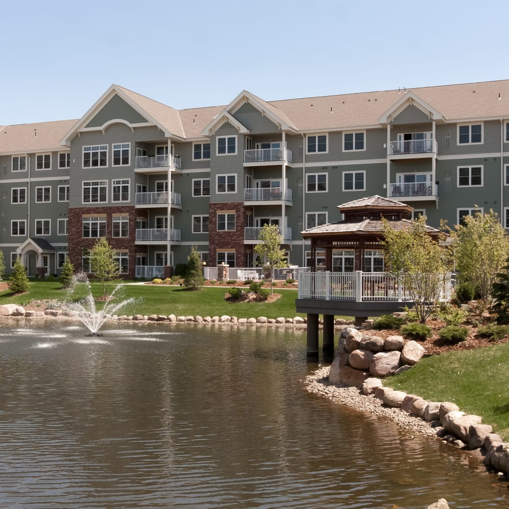 Exterior view with a pond at Applewood Pointe Bloomington at Southtown in Bloomington, Minnesota.