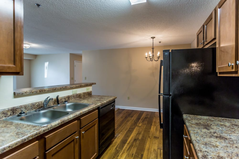 Wood flooring in an apartment kitchen at Park Ridge Apartments in Jackson, Tennessee