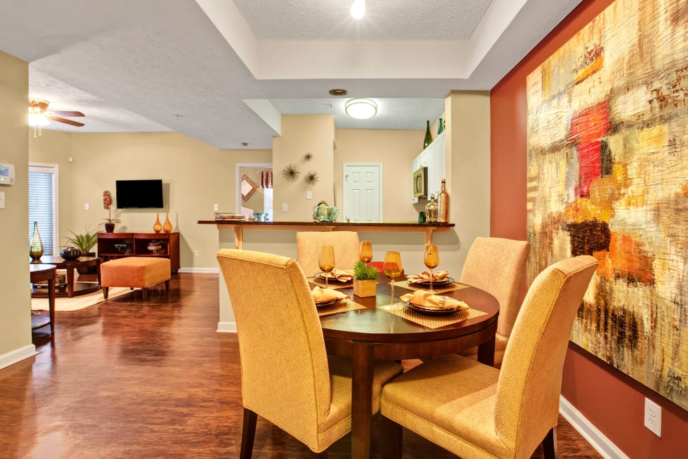 Well decorated dining area with with orange accent wall at Avia at North Springs in Atlanta, Georgia