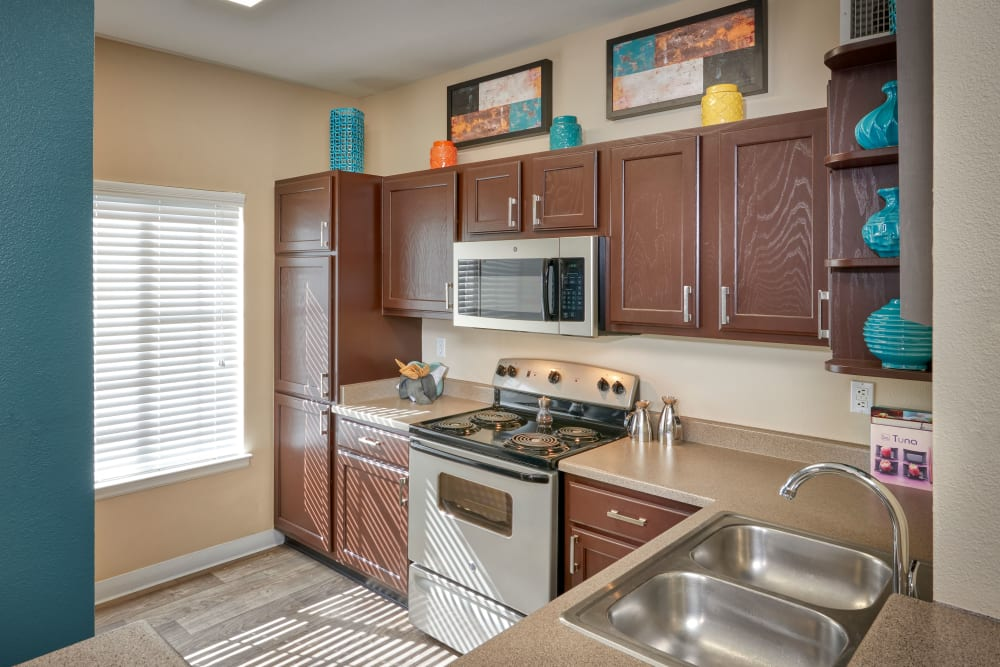 A kitchen with plenty of cabinet space at Skyecrest Apartments in Lakewood, Colorado