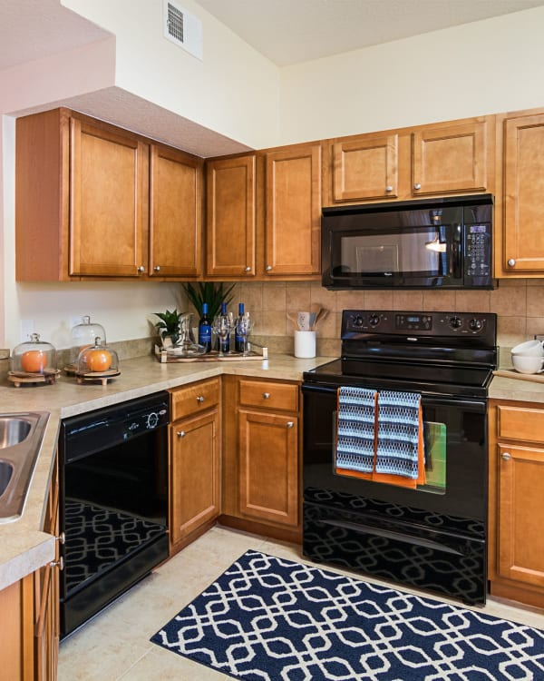 Fully equipped kitchen at Landings at Four Corners in Davenport, Florida