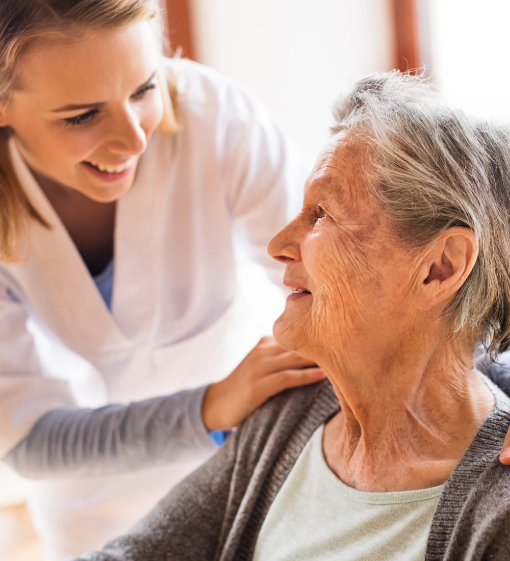 Resident and caretaker talking at Retirement Center Management in Houston, Texas