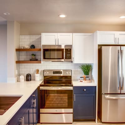 Newly renovated kitchen with stainless-steel appliances and a subway tile backsplash in a model home at Harbor Point Apartments in Mill Valley, California