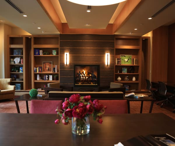 Fireplace in the library at All Seasons of Birmingham in Birmingham, Michigan