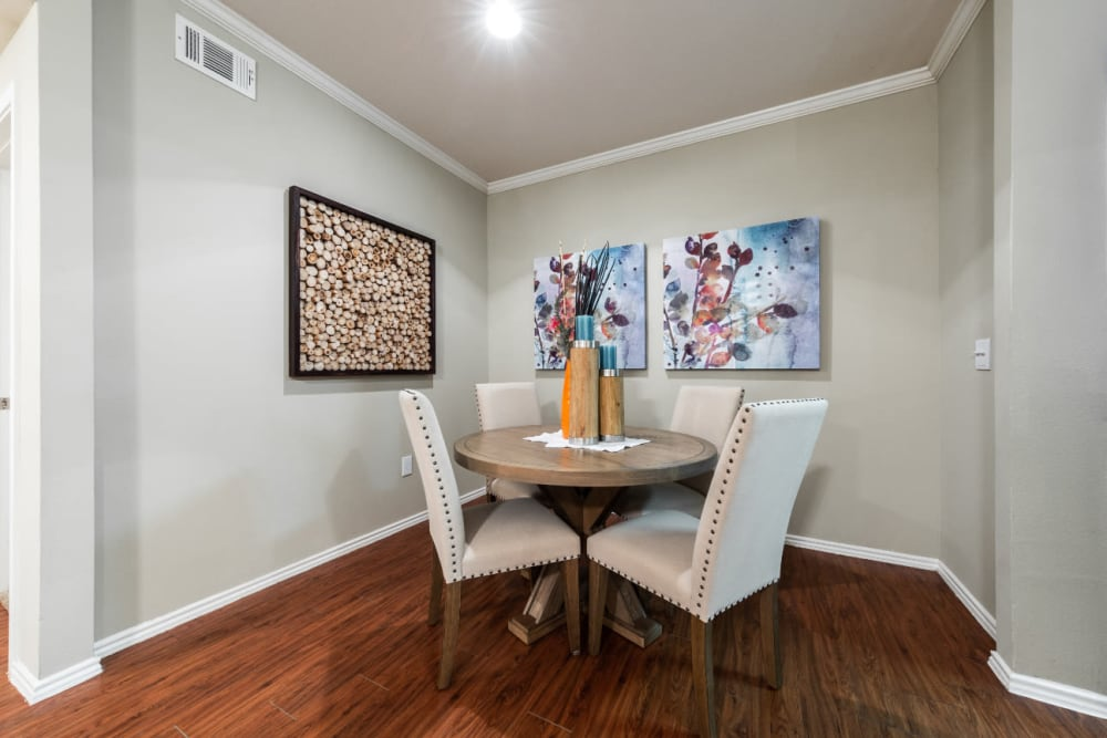 Dining room with wood style flooring at Marquis at Ladera Vista in Austin, Texas