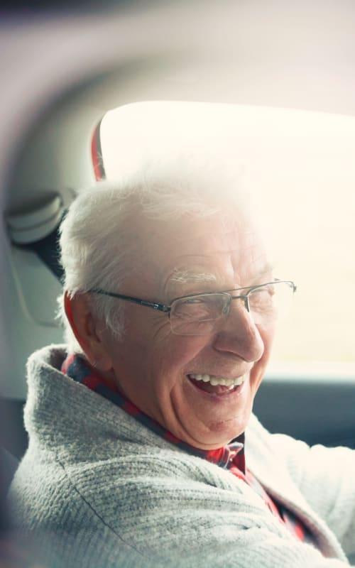 Senior man driving a car near Jaybird Senior Living