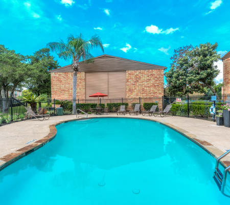 A swimming pool that is great for entertaining at Newport Oaks Apartments in Alvin, Texas