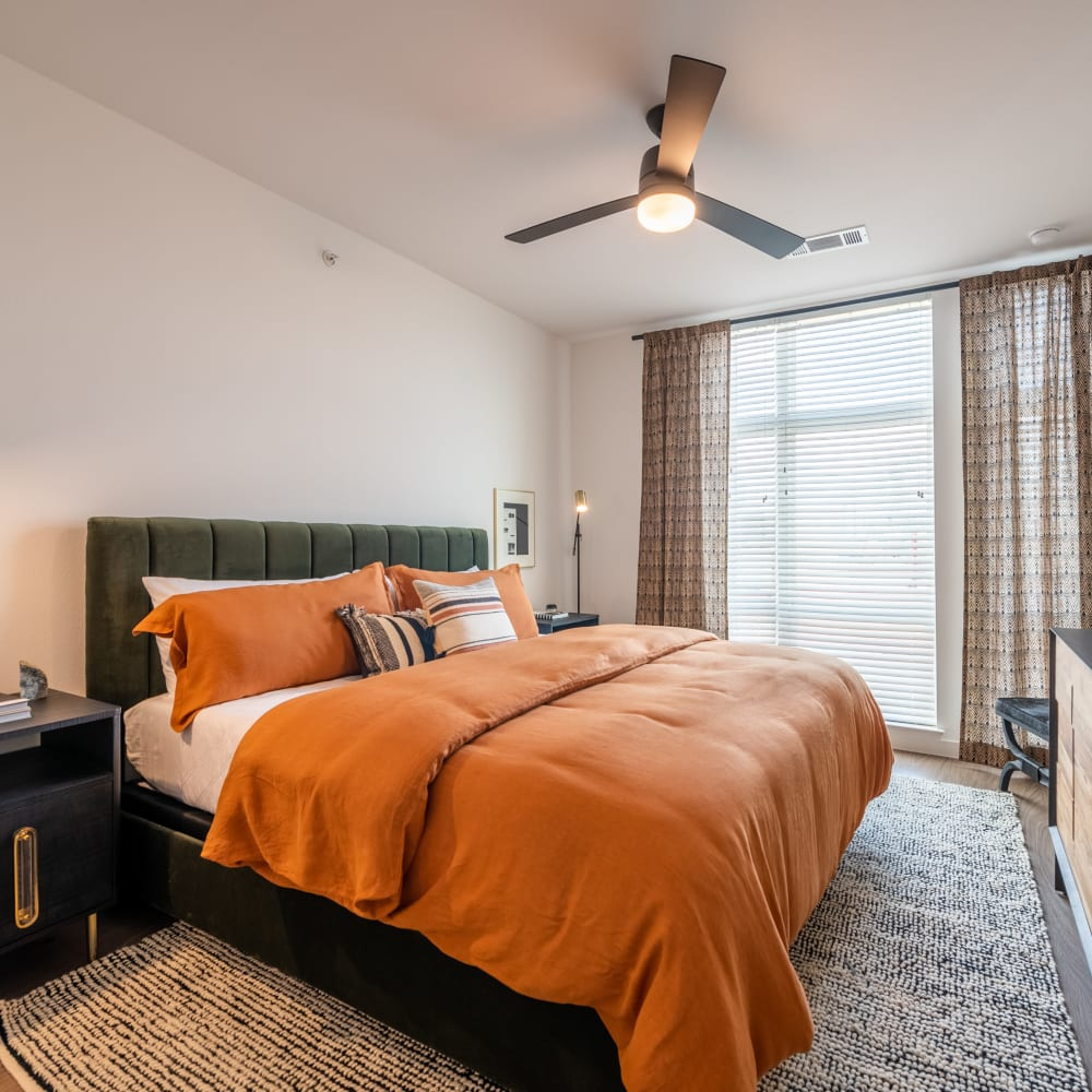 Cute bedroom with tons of natural light at The Langford in Dallas, Texas