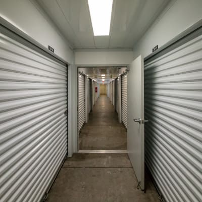 Hall of self storage units for rent at Neighborhood Storage in Belleview, FL