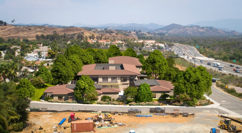 Side view of building and highway at Carefield Living Bonsall in Bonsall, California.