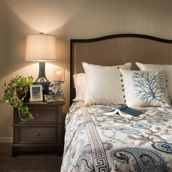 Well-decorated master bedroom of model home at San Sonoma in Tempe, Arizona