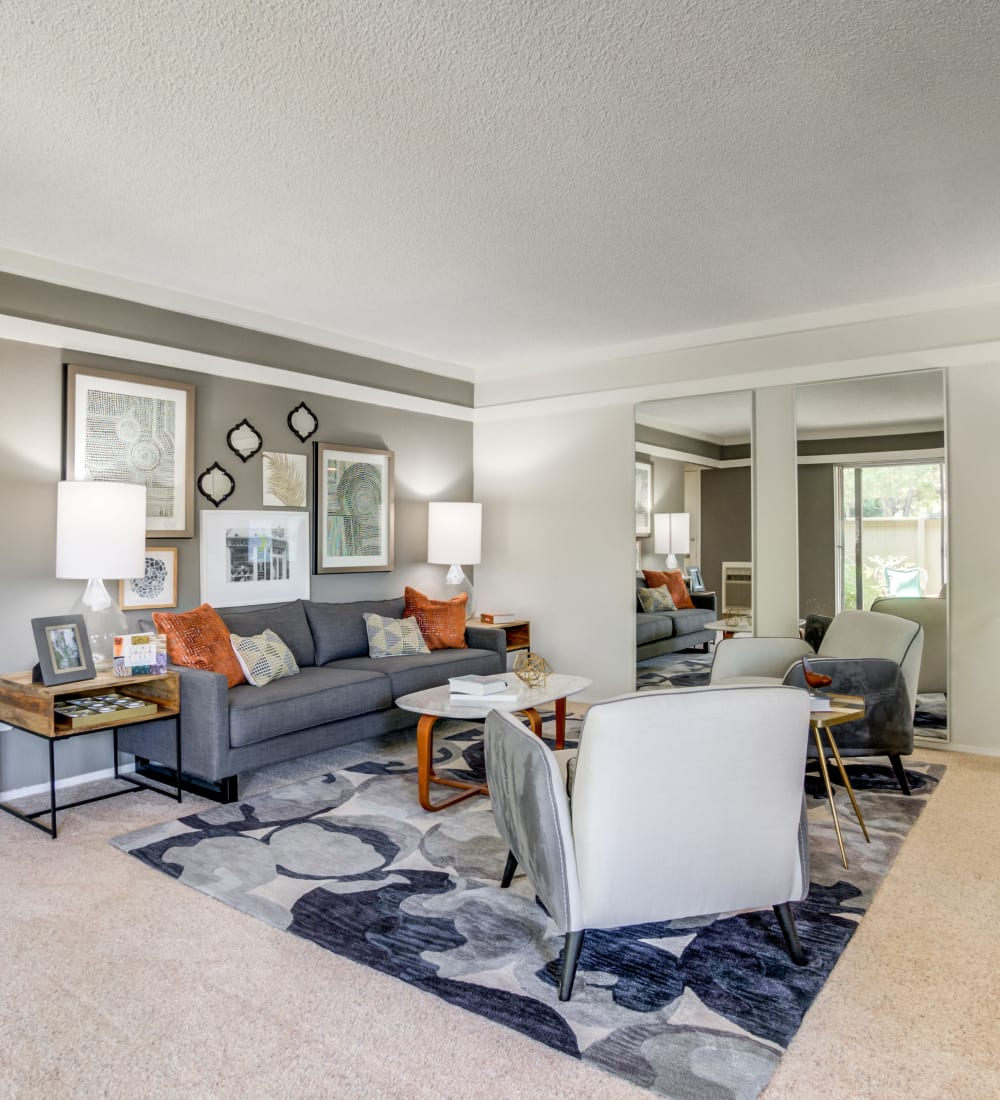 Well-decorated living area with an accent wall in a model home at Sofi Fremont in Fremont, California