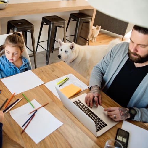 REsident working from home with his kids and dog at The Alcove in Smyrna, Georgia
