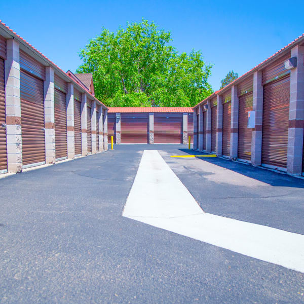 Outdoor storage units with bright doors at StorQuest Self Storage in Aurora, Colorado