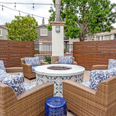Beautifully decorated fire pit area with comfortable seating at Sofi Westview in San Diego, California
