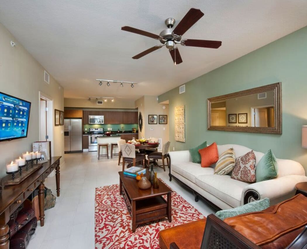 Spacious open-concept floor plan with ceiling fan in the living area in a model home at Doral View Apartments in Miami, Florida