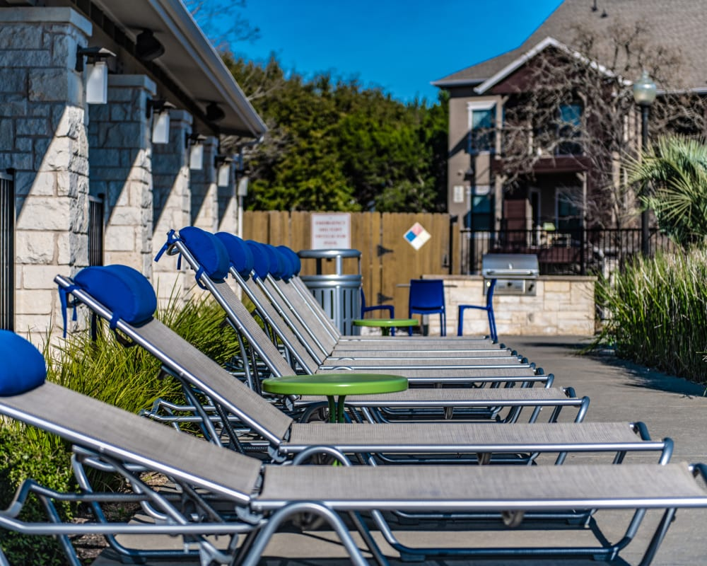 Poolside lounge chairs at Ethos Apartments in Austin, Texas