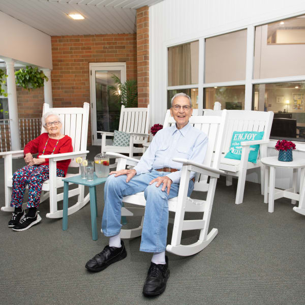 Resident couple on the patio at Royalton Woods in North Royalton, Ohio