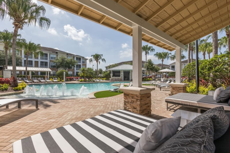 Poolside gazebos with chairs at Luxe at 1820 in Tampa, Florida