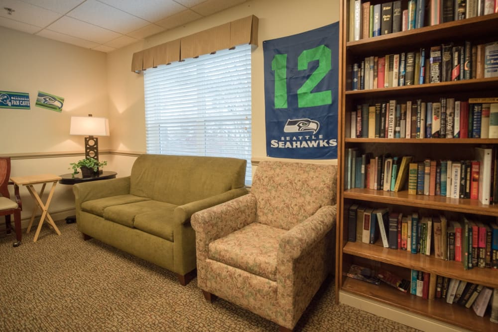 Community study with books and couches at Kenmore Senior Living in Kenmore, Washington