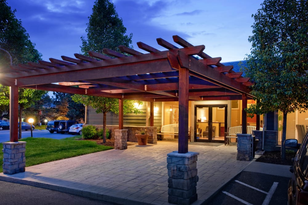 Entrance to leasing center at Hampden Heights Apartments in Denver, Colorado lit up on a beautiful evening