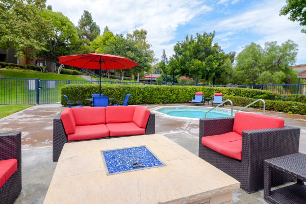 Outdoor fire pit and pool-side lounge at Presidio at Rancho Del Oro in Oceanside, California