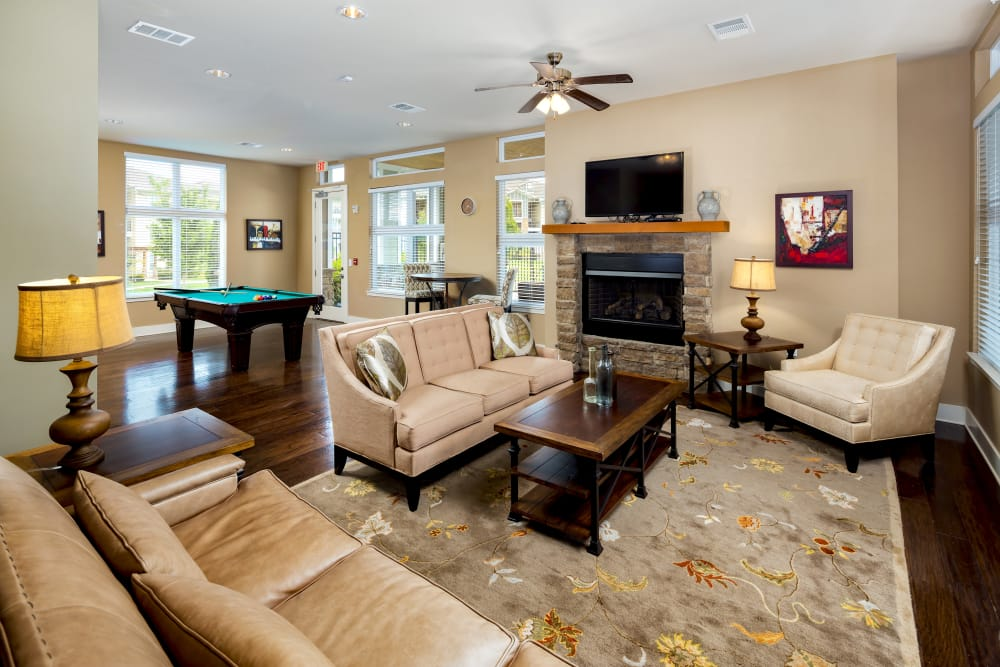 Model unit featuring plenty of lounging and a pool table at The Preserve at Hardin Valley in Knoxville, Tennessee