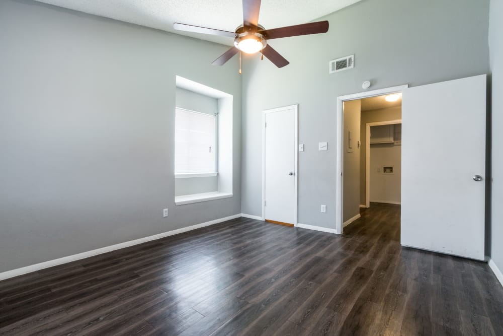 An apartment bedroom leading to the laundry room at Northchase Apartments in Austin, Texas