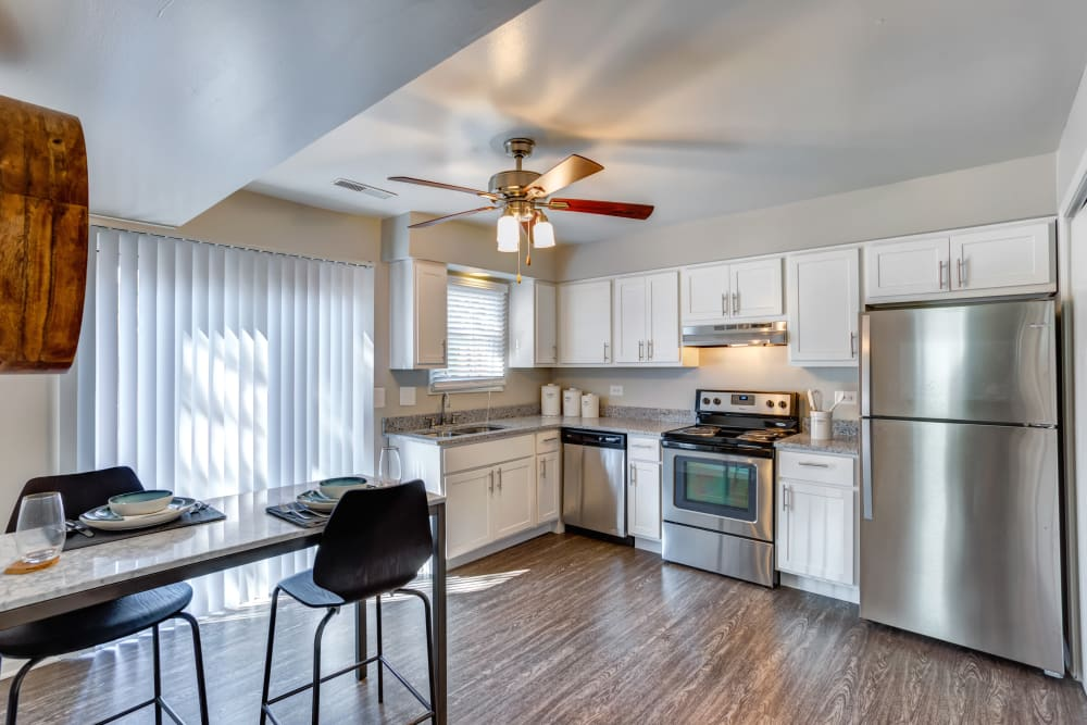Kitchen with a ceiling fan and back porch access at Aspen Place in Aurora, Illinois
