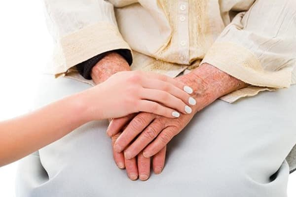 woman holding hand of senior woman at The Retreat at Berryville in Berryville, Virginia