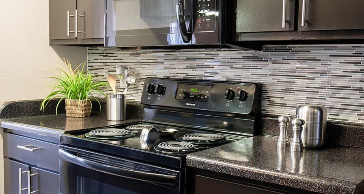 Modern kitchen at Greentree Apartments in Carrollton, Texas