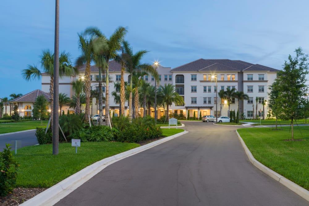 Front entrance in the evening at Merrill Gardens at ChampionsGate in ChampionsGate, Florida.
