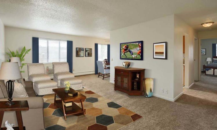 Spacious living room at Knollwood Manor Apartments in Fairport, NY