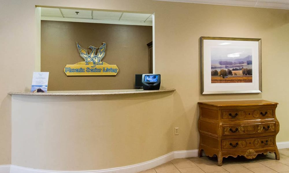 Reception desk at Addington Place of Johns Creek in Johns Creek, GA